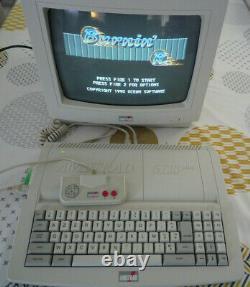 Amstrad CPC 6128 plus-Complet Courroie neuve-ECRAN CM14- très bon état + JEUX