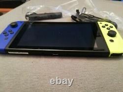 Console Nintendo Switch Complet + Boite Tres Bon Etat Mannettes Jaune Bleue