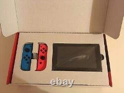 Console Nintendo Switch Neon, 32 Go, joy-con bleu et rouge Très Bon Etat