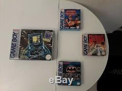 Game boy vintage en très bonne état général satisfait ou remboursé! Avec 4 jeux