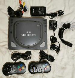 SNK Neo Geo CDZ avec 2 manettes & câbles officiels très bon état & fonctionnelle