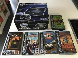 Sega Saturn complète en boite avec 5 Jeux en très bon état